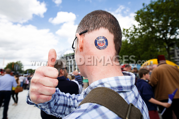 A Bath Rugby supporter. Aviva Premiership Final, between Bath Rugby and Saracens on May 30, 2015 at Twickenham Stadium in London, England. Photo by: Rogan Thomson for Onside Images