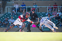 Salt River Rafters catcher Tres Barrera (12), of the Washington Nationals organization, attempts to apply the tag to Charles Leblanc (12) as he slides home in front of home plate umpire Junior Valentine as Lane Thomas (23) looks on during an Arizona Fall League game against the Surprise Saguaros at Salt River Fields at Talking Stick on November 5, 2018 in Scottsdale, Arizona. Salt River defeated Surprise 4-3 . (Zachary Lucy/Four Seam Images)