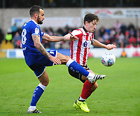 Lincoln City's Alex Woodyard vies for possession with Chesterfield's Robbie Weir<br /> <br /> Photographer Andrew Vaughan/CameraSport<br /> <br /> The EFL Sky Bet League Two - Lincoln City v Chesterfield - Saturday 7th October 2017 - Sincil Bank - Lincoln<br /> <br /> World Copyright &copy; 2017 CameraSport. All rights reserved. 43 Linden Ave. Countesthorpe. Leicester. England. LE8 5PG - Tel: +44 (0) 116 277 4147 - admin@camerasport.com - www.camerasport.com