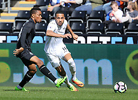SWANSEA, WALES - MARCH 25:Kenji Gorre of Swansea City is closely marked by Musa Yahaya of Porto during the Premier League International Cup Semi Final match between Swansea City and Porto at The Liberty Stadium on March 25, 2017 in Swansea, Wales. (Photo by Athena Pictures)