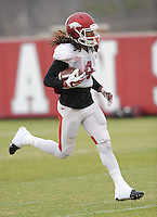 NWA Media/ANDY SHUPE - Arkansas receiver Keon Hatcher catches a pass during practice Saturday, Dec. 13, 2014, at the university's practice facility in Fayetteville.