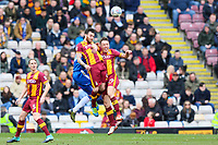 Tony McMahon and Romain Vincelot of Bradford City in the air during the Sky Bet League 1 match between Bradford City and Gillingham at the Northern Commercial Stadium, Bradford, England on 24 March 2018. Photo by Thomas Gadd.