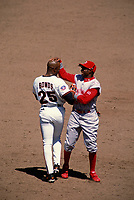 SAN FRANCISCO, CA:  Barry Bonds of the San Francisco Giants jokes with Deion Sanders of the Cincinnati Reds during a game at Candlestick Park in San Francisco, California in 1997. (Photo by Brad Mangin)
