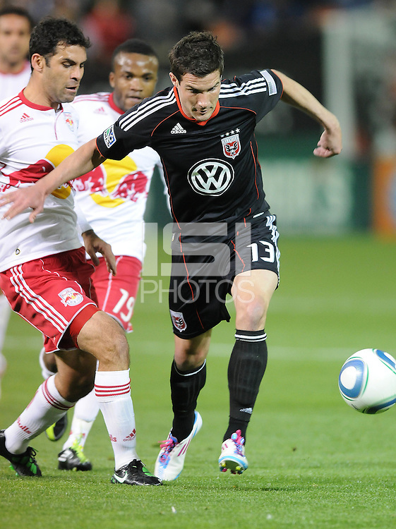 DC United midfielder Chris Pontius (13) shields the ball against New York Red Bulls defender Rafael Marquez (4)  The New York Red Bulls defeated DC United 4-0, at RFK Stadium, Thursday April 21, 2011.
