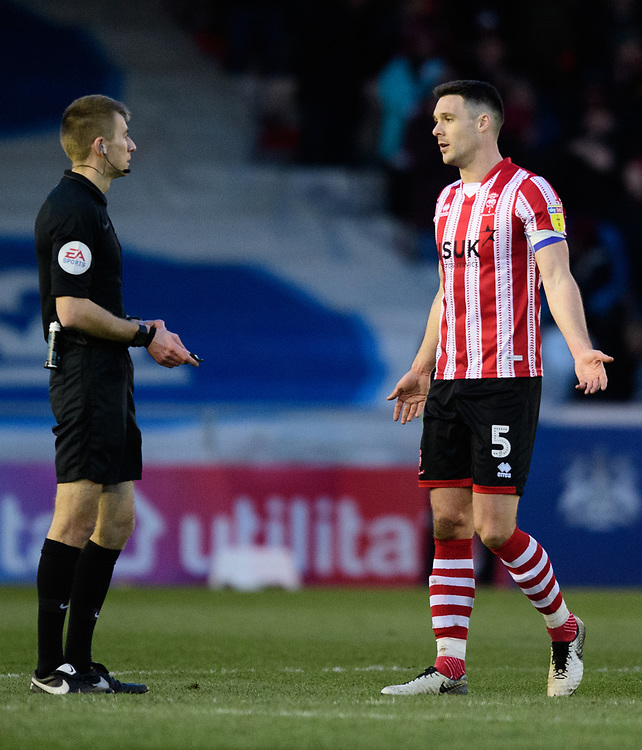 Lincoln City's Jason Shackell speaks to Referee Michael Salisbury at the end of the game<br /> <br /> Photographer Chris Vaughan/CameraSport<br /> <br /> The EFL Sky Bet League Two - Lincoln City v Northampton Town - Saturday 9th February 2019 - Sincil Bank - Lincoln<br /> <br /> World Copyright © 2019 CameraSport. All rights reserved. 43 Linden Ave. Countesthorpe. Leicester. England. LE8 5PG - Tel: +44 (0) 116 277 4147 - admin@camerasport.com - www.camerasport.com