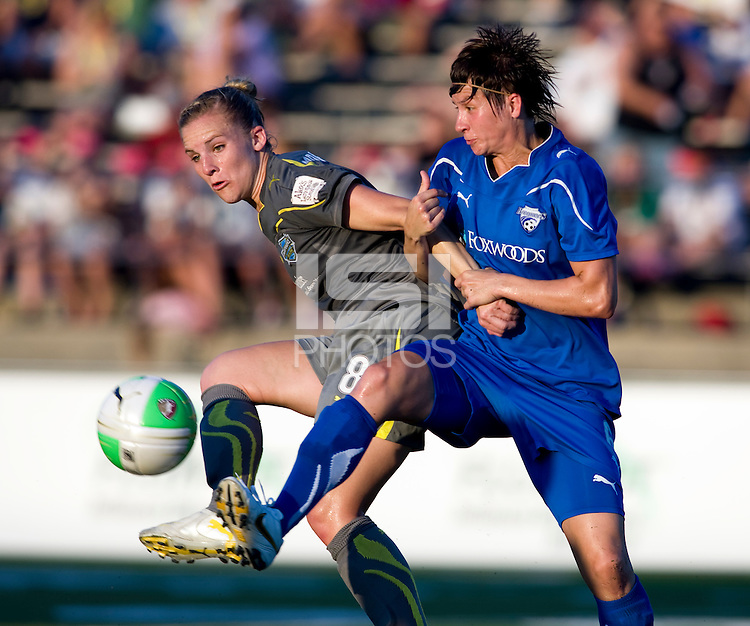 Amy LePeilbet (6) of the Boston Breakers clears the ball away from Amy Rodriguez (8) of the Philadelphia Independence during a game at John A. Farrell Stadium in West Chester, PA.  Boston defeated Philadelphia, 2-1.