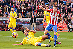 Atletico de Madrid Kevin Gameiro and UD Las Palmas Pablo Mauricio Lemos during La Liga match between Atletico de Madrid and UD Las Palmas at Vicente Calderon Stadium in Madrid, Spain. December 17, 2016. (ALTERPHOTOS/BorjaB.Hojas)