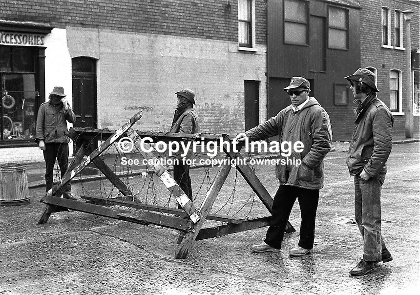 Ulster Defence Association (UDA) members man a temporary barricade in the Woodvale district of Belfast, N Ireland, UK. NI Troubles. Ref: 19720630001...Copyright Image from Victor Patterson, 54 Dorchester Park, Belfast, UK, BT9 6RJ..Tel: +44 28 9066 1296.Mob: +44 7802 353836.Voicemail +44 20 8816 7153.Skype: victorpattersonbelfast.Email: victorpatterson@mac.com.Email: victorpatterson@ireland.com (back-up)..IMPORTANT: If you wish to use this image or any other of my images please go to www.victorpatterson.com and click on the Terms & Conditions. Then contact me by email or phone with the reference number(s) of the image(s) concerned.