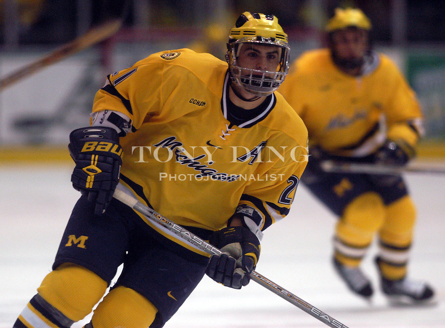 Michigan left wing, soph. Eric Nystrom (21) during the Wolverine's match with Alaska Fairbanks on Saturday, October 26, 2002 (Tony Ding/Daily).