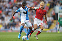 Blackburn Rovers' Amari'i Bell is tackled by Charlton Athletic's George Lapslie<br /> <br /> Photographer Kevin Barnes/CameraSport<br /> <br /> The EFL Sky Bet Championship - Blackburn Rovers v Charlton Athletic - Saturday 3rd August 2019 - Ewood Park - Blackburn<br /> <br /> World Copyright © 2019 CameraSport. All rights reserved. 43 Linden Ave. Countesthorpe. Leicester. England. LE8 5PG - Tel: +44 (0) 116 277 4147 - admin@camerasport.com - www.camerasport.com