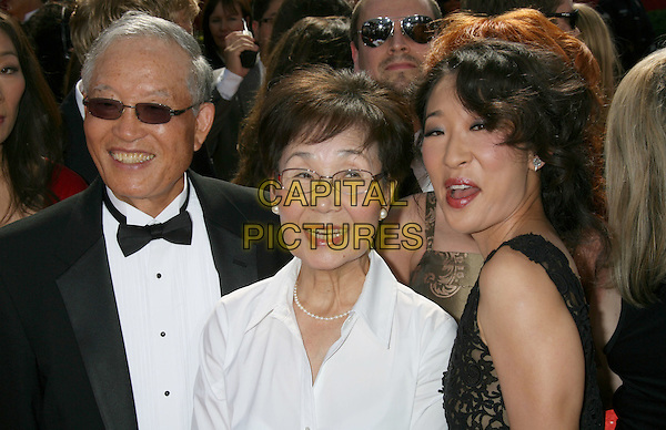 SANDRA OH & HER PARENTS .60th Annual Primetime Emmy Awards held at the Nokia Theatre, Los Angeles, California, USA, .21 September 2008..emmys half length mother father mom dad family .CAP/ADM/MJ.©Michael Jade/Admedia/Capital Pictures