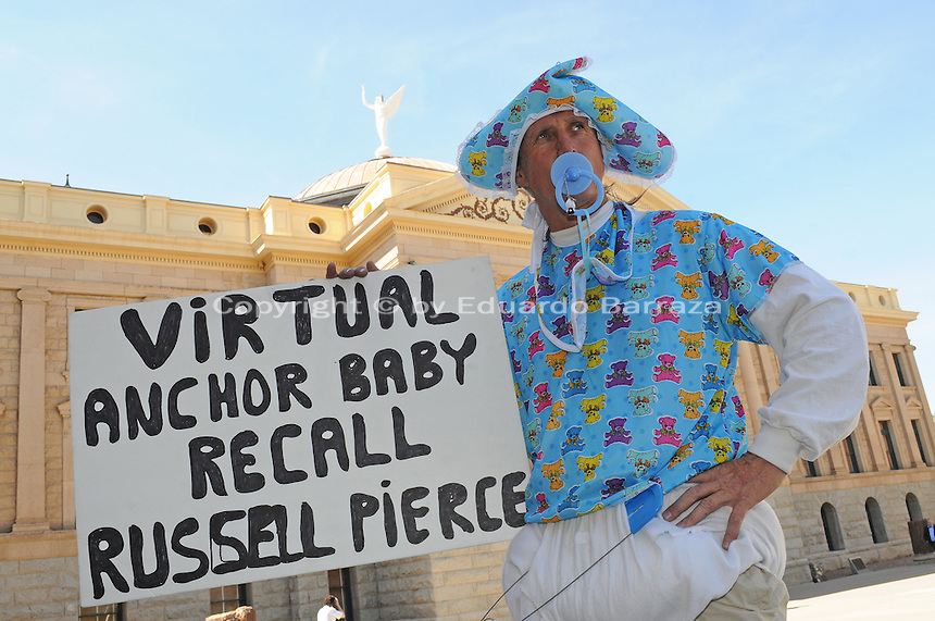 "Phoenix, Arizona - Jorge Mendez dresses as a ""virtual anchor baby"" outside the Arizona State Senate building to protest attempts by state senators to change to the 14th Amendment of the United States Constitution. Senators are seeking to deny citizenship rights to children born in U.S. to parents who are in the country illegally. Photo by Eduardo Barraza © 2011"