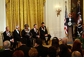 Washington, DC - December 6, 2009 -- United States President Barack Obama hosts the 2009 Kennedy Center Honorees at an East Room reception in the White House in Washington, D.C. on Sunday, December 6, 2009. Shown with the president on stage are (l-r) honorees Mel Brooks, Dave Brubeck, Grace Bumbry, Robert DeNiro, and Bruce Springsteen. .Credit: Martin H. Simon / Pool via CNP