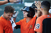 T.J. Nichting (17) of the Frederick Keys is congratulated by his teammates after hitting a solo home run in the first inning against the Winston-Salem Dash at BB&T Ballpark on July 26, 2018 in Winston-Salem, North Carolina. The Keys defeated the Dash 6-1. (Brian Westerholt/Four Seam Images)