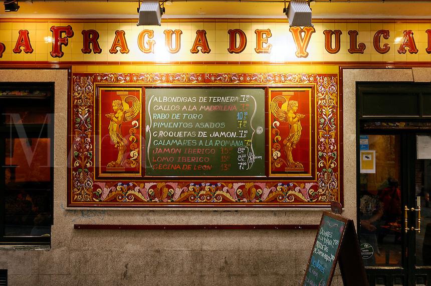 La Fragua de Vulcano restaurant with ornate tiling facade and menu, Madrid, Spain