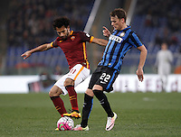 Calcio, Serie A: Roma vs Inter. Roma, stadio Olimpico, 19 marzo 2016.<br /> Roma&rsquo;s Mohamed Salah, left, is challenged by FC Inter&rsquo;s Adem Ljajic during the Italian Serie A football match between Roma and FC Inter at Rome's Olympic stadium, 19 March 2016. The game ended 1-1.<br /> UPDATE IMAGES PRESS/Isabella Bonotto