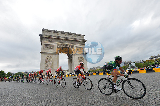 The peloton with Thomas VOECKLER (FRA) Europcar on the front pass the Arc de Triomphe on the Champs Elysees in Paris during Stage 21 of the 2015 Tour de France running 109.5km from Sevres to Paris - Champs Elysees, France. 26th July 2015.<br /> Photo: ASO/B.Bade/Newsfile