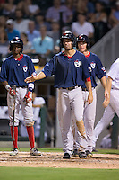 Deven Marrero (front), Jose Vinicio (left), and Jantzen Witte (31) wait to greet Chris Dominguez (not pictured) at home plate following Dominguez's 3-run home run against the Charlotte Knights at BB&T BallPark on July 6, 2016 in Charlotte, North Carolina.  The Knights defeated the Red Sox 8-6.  (Brian Westerholt/Four Seam Images)
