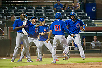 AZL Cubs pinch hitter Yovanny Cuevas (61) is congratulated by Alfredo Colorado (75), Luis Vazquez (1), and Jonathan Sierra (22) after scoring a run against the AZL Giants on September 5, 2017 at Scottsdale Stadium in Scottsdale, Arizona. AZL Cubs defeated the AZL Giants 10-4 to take a 1-0 lead in the Arizona League Championship Series. (Zachary Lucy/Four Seam Images)