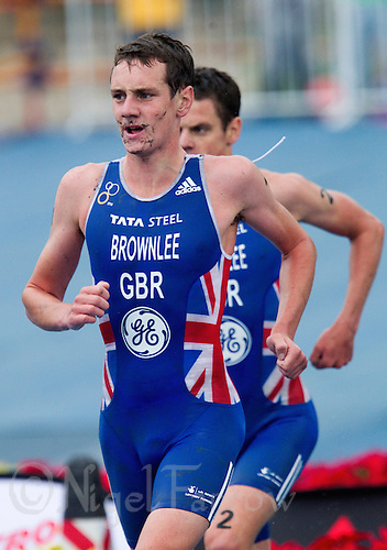 10 SEP 2011 - BEIJING, CHN - Britain's Alistair Brownlee leads brother Jonathan Brownlee during the 2011 Elite Mens ITU World Championship Series Grand Final Triathlon .(PHOTO (C) NIGEL FARROW)