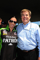 Jun. 3, 2012; Englishtown, NJ, USA: NHRA funny car driver Alexis DeJoria (left) with Toyota executive Bob Carter during the Supernationals at Raceway Park. Mandatory Credit: Mark J. Rebilas-
