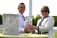 Connections of Sun Maiden receive their trophy for winning The Smith & Williamson Fillies' Novice Stakes (Class 5) during Afternoon Racing at Salisbury Racecourse on 17th May 2018