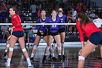 Molly Livingston (22), Megan Kennedy (6), and Savannah Angel (10) of the High Point Panthers await a serve during the match against the Liberty Flames at the Millis Athletic Center on September 23, 2016 in High Point, North Carolina.  The Panthers defeated the Flames 3-1.   (Brian Westerholt/Sports On Film)