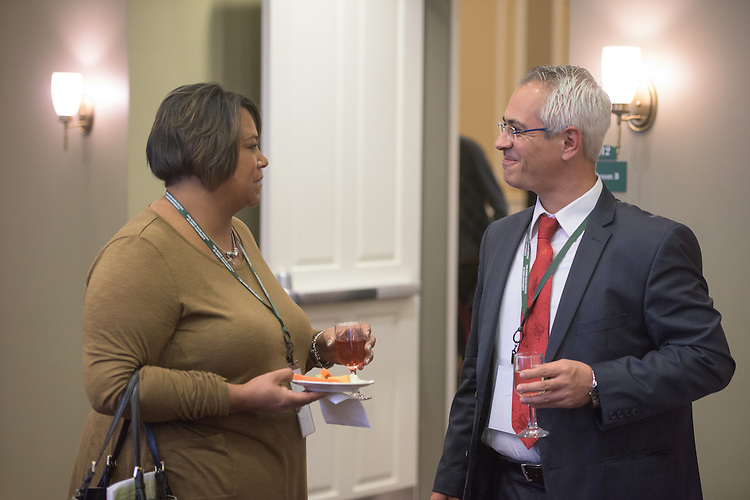 Dr. Nick Panagopoulos of the University of Alabama, speaks with Ragina Mullucey during a break in the 2016 Schey Sales Symposium held in Baker Center on November 3, 2016.
