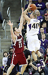 Aron Baynes (#11) applies pressure to Jon Brockman (#40)during the Cougars Pac-10 conference showdown with the University of Washington on March 7, 2009, in Seattle, Washington.  Both teams came in to the game on a roll, and in a hard fought battle, the Huskies prevailed 67-60 to wrap up the regular season Pac-10 championship.