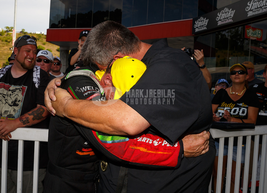 Jun 18, 2017; Bristol, TN, USA; NHRA top fuel driver Clay Millican celebrates with team owner Doug Stringer after winning the Thunder Valley Nationals at Bristol Dragway. Mandatory Credit: Mark J. Rebilas-USA TODAY Sports