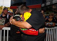 Jun 18, 2017; Bristol, TN, USA; NHRA top fuel driver Clay Millican celebrates with team owner Doug Stringer after winning the Thunder Valley Nationals at Bristol Dragway. Mandatory Credit: Mark J. Rebilas-USA TODAY Sports