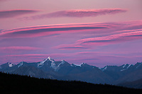 Pink colored lenticular clouds over the Alaska Range mountains in Denali National Park, Interior, Alaska