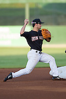 Kannapolis Intimidators shortstop Eddy Alvarez (1) attempts to turn a double play against the Greensboro Grasshoppers at CMC-NorthEast Stadium on August 30, 2014 in Kannapolis, North Carolina.  The Intimidators defeated the Grasshoppers 3-1.  (Brian Westerholt/Four Seam Images)