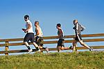 Group of men running on the river walk