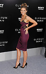 WESTWOOD, CA- AUGUST 07: Actress Stana Katic arrives at the Los Angeles premiere of 'Elysium' at Regency Village Theatre on August 7, 2013 in Westwood, California.