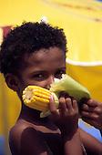 Rio de Janeiro, Brazil. Young boy eating corn on the cob.