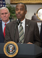 United States Secretary of Housing and Urban Development Ben Carson makes remarks prior to US President Donald J. Trump signing a proclamation to honor Dr. Martin Luther King, Jr. Day in the Roosevelt Room of the White House in Washington, DC on Friday, January 12, 2018.  Looking on at left is US Vice President Mike Pence.<br /> Credit: Ron Sachs / CNP /MediaPunch