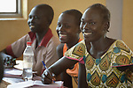 An older woman sits in a classroom with other students in the Loreto Primary School in Rumbek, South Sudan. The Loreto Sisters began a secondary school for girls in 2008, with students from throughout the country, but soon after added a primary in response to local community demands. Some of the students are adults, and participate in an afternoon accelerated learning program.