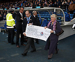 Rangers Supporters Erskine Appeal present a cheque for £106,438 at half-time