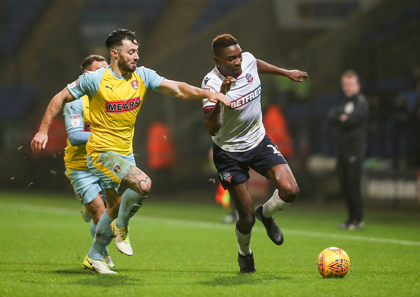 Bolton Wanderers' Sammy Ameobi competing with Rotherham United's Richie Towell<br /> <br /> Photographer Andrew Kearns/CameraSport<br /> <br /> The EFL Sky Bet Championship - Bolton Wanderers v Rotherham United - Wednesday 26th December 2018 - University of Bolton Stadium - Bolton<br /> <br /> World Copyright © 2018 CameraSport. All rights reserved. 43 Linden Ave. Countesthorpe. Leicester. England. LE8 5PG - Tel: +44 (0) 116 277 4147 - admin@camerasport.com - www.camerasport.com