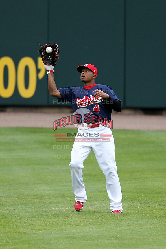 Memphis Redbirds outfielder Adron Chambers #4 during a game versus the Round Rock Express at Autozone Park on April 30, 2011 in Memphis, Tennessee.  Memphis defeated Round Rock by the score of 10-7.  Photo By Mike Janes/Four Seam Images