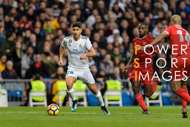 Marco Asensio of Real Madrid (L) in action against Lionel Carole of Sevilla FC (R) during La Liga 2017-18 match between Real Madrid and Sevilla FC at Santiago Bernabeu Stadium on 09 December 2017 in Madrid, Spain. Photo by Diego Souto / Power Sport Images