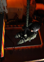 Helicopter Visit Board Search and Seizure members practice fast roping in the hangar bay aboard USS Abraham Lincoln.