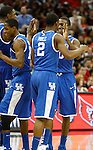 UK players celebrate near the end of the UK vs. UofL game on Friday, December 31, 2010. Photo by Latara Appleby | Staff