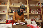 "A Palestinian artist Dima Sha'sha'a ""owner of Tezzkar Project"" works at her shop in Gaza city on February 28, 2018. Dima and her brother Hamdi take the drawing on dishes, cardboard and glass as a job for nearly seven years. International Women's Day is annually held on March 8 to celebrate women's achievements throughout history and across nations. It is also known as the United Nations (UN) Day for Women's Rights and International Peace. Photo by Mahmoud Ajour"