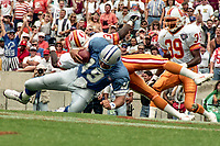 Scott Mitchell is sacked, Detroit Lions at Tampa Bay Buccaneers NFL football game won by Tampa Bay 24-14 at Tampa Stadium, in Tampa , Florida on Sunday October 2, 1994 . (Photo by Brian Cleary/bcpix.com)