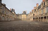 The Cour Ovale, the central courtyard from which 16th and 17th century facades spread out from the original keep, Chateau de Fontainebleau, France. The Palace of Fontainebleau is one of the largest French royal palaces and was begun in the early 16th century for Francois I. It was listed as a UNESCO World Heritage Site in 1981. Picture by Manuel Cohen
