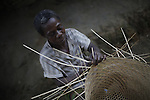 Woman making a basket. Cameroon.