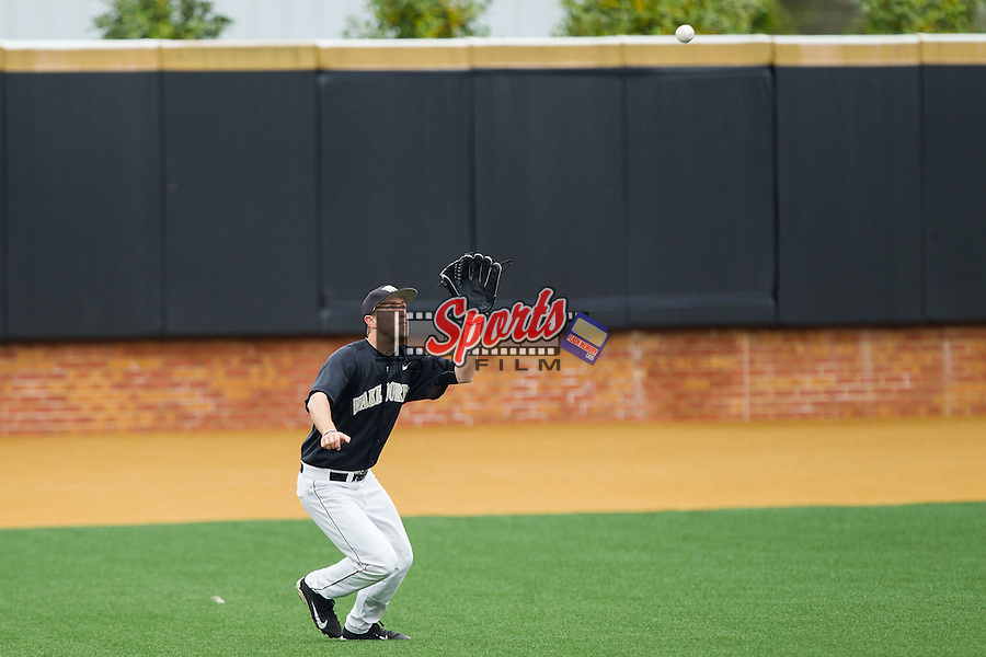 Wake Forest Demon Deacons left fielder Grant Shambley (43) tracks a fly ball against the Florida State Seminoles at Wake Forest Baseball Park on April 19, 2014 in Winston-Salem, North Carolina.  The Seminoles defeated the Demon Deacons 4-3 in 13 innings.  (Brian Westerholt/Sports On Film)