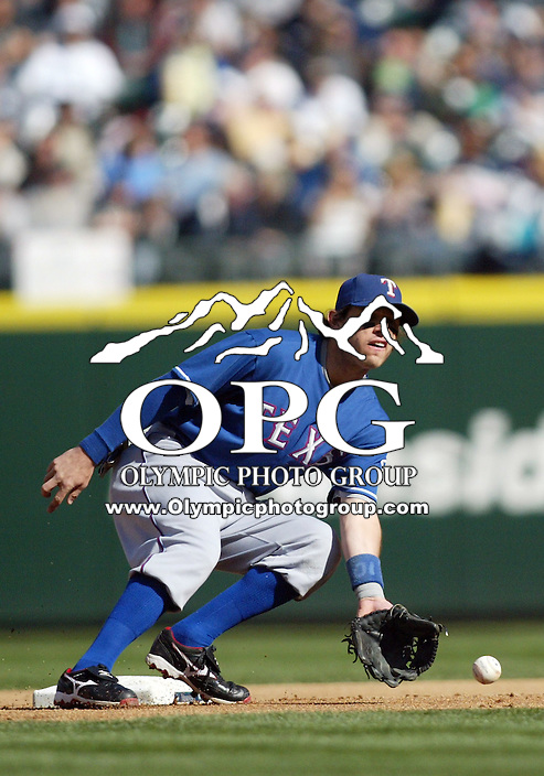 04 October 2009:  Texas Rangers second baseman Ian Kinsler sets up to lay the tag on Seattle Mariners #16 Josh Wilson at second base.  Wilson was safe on the play. Seattle won 4-3 over the Texas Rangers at Safeco Field in Seattle, Washington.